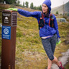 Despite the snow at the pass, we were still having a good time and loving the Alpine.  Here, Annalise took a moment to goof off at the Alberta/BC boundary.  As we dropped down from the pass, the snow turned to rain which hung around for the next hour or so... I had to tuck the camera under my jacket to keep it from getting too wet, plus the lens was fogged over by this point.