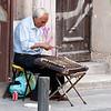 Athens, Street musician playing the Santouri