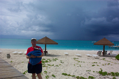 Jeane gathers up our books and towels, since it looks like we're about to get clobbered by another storm.