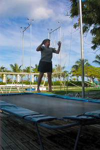 Jeane practices on the trampoline.