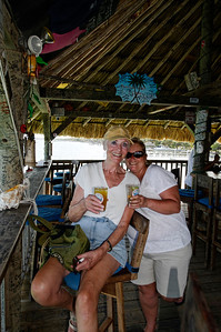 PJ and Mo drinking at the Palapa Bar, Ambergris Caye Belize.