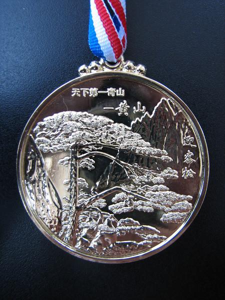 memory medal for reaching the summit of the Lotus Peak