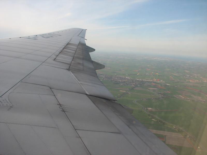 flight Beijing - Amsterdam, view: Dutch fields of flowering bulbs