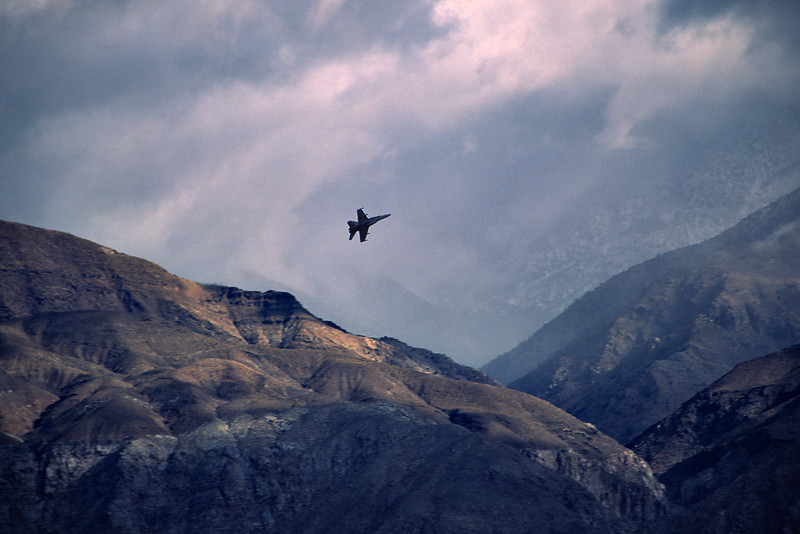 An F-18 maneuvers as a storm clears from the Panamint Range.
