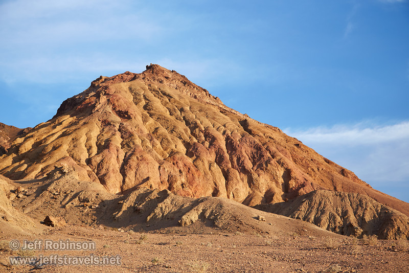 A textured hill of reds and browns under partly-cloudy blue sky.(3/17/2013, Artists Drive Loop, Death Valley NP)<br /> <br /> EF24-105mm f/4L IS USM @ 55mm f/5.6 1/160s ISO400