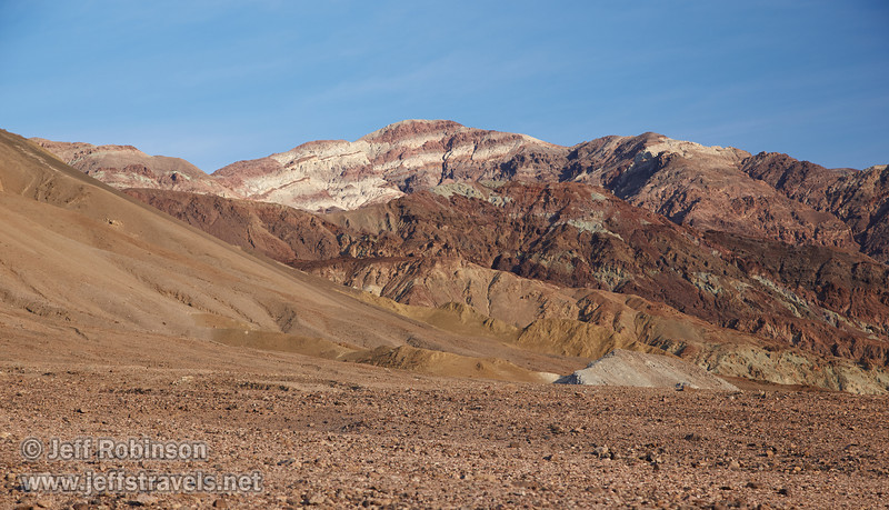 Mountains with multiple colors of reds, browns, yellows, and faint greens under partly-cloudy blue sky.(3/17/2013, Artists Drive Loop, Death Valley NP)<br /> <br /> EF24-105mm f/4L IS USM @ 80mm f/6.3 1/200s ISO400