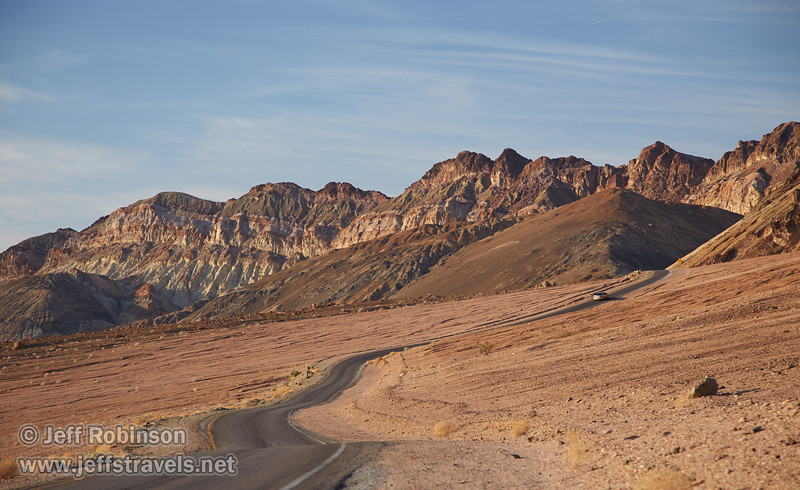 Artists Drive leads to mountains with multiple colors of reds, browns, and yellows under partly-cloudy blue sky.(3/17/2013, Artists Drive Loop, Death Valley NP)<br /> <br /> EF24-105mm f/4L IS USM @ 105mm f/5.6 1/250s ISO320