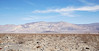 """NE view of rusted junk behind the RV park, including a metal bin labeled """"Futurism = Turism"""". The Panamint Valley, Panamint Dunes (sandy area on left in front of the mountains) and the Panamint Range are in the background. (3/17/2013, Panamint Springs Resort, Death Valley Trip)<br /> <br /> EF24-105mm f/4L IS USM @ 35mm f/9 1/320s ISO125"""