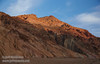The last sunlight hits mountains of reds, browns, and yellows under partly-cloudy blue sky.(3/17/2013, Artists Drive Loop, Death Valley NP)<br /> <br /> EF24-105mm f/4L IS USM @ 58mm f/5.6 1/160s ISO400