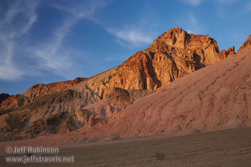 The last sunlight hits mountains of reds, browns, and yellows under partly-cloudy blue sky.(3/17/2013, Artists Drive Loop, Death Valley NP)<br /> <br /> EF24-105mm f/4L IS USM @ 45mm f/8 1/200s ISO500