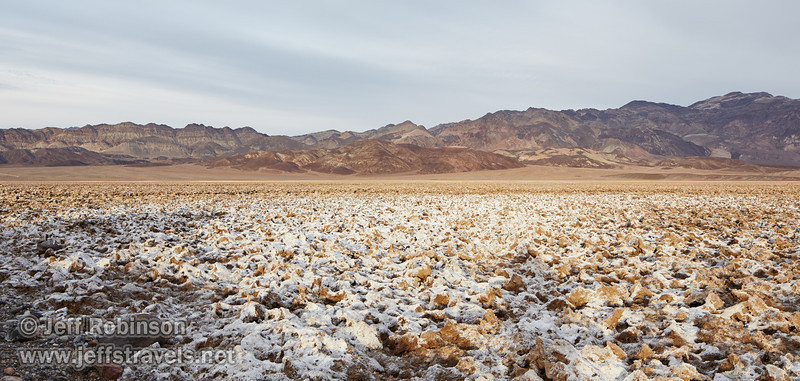 Sun on the very rough salt structures (a bit like the Devils Golf Course) with colorful mountains in the background (Artist's Palette area). (3/19/2013, West Side Road, Death Valley NP)<br /> TS-E24mm f/3.5L II @ 24mm f/8 1/100s ISO400