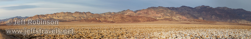 Panoramic sweep of sun on the very rough salt structures (a bit like the Devils Golf Course) with colorful mountains in the background (Artist's Palette area). (3/19/2013, West Side Road, Death Valley NP)<br /> EF24-105mm f/4L IS USM @ 73mm f/8 1/160s ISO400