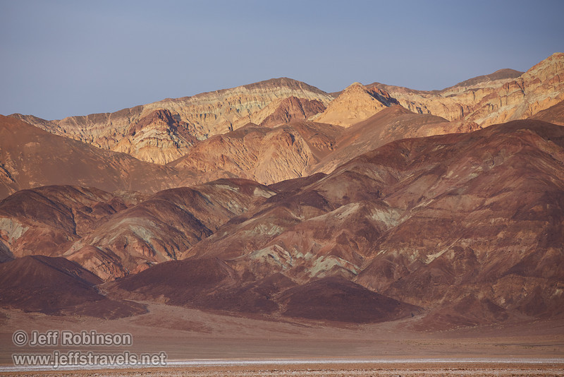 The very rough salt structures (a bit like the Devils Golf Course) in shade with colorful mountains in sun in the background (Artist's Palette area). (3/19/2013, West Side Road, Death Valley NP)<br /> EF70-200mm f/2.8L IS II USM @ 200mm f/5.6 1/320s ISO400