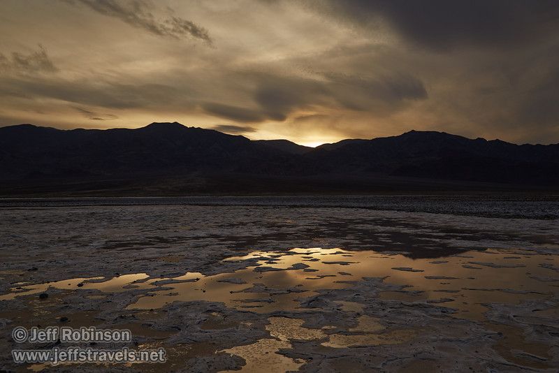Light reflecting in puddles/pools in the salt flat. The sun has dropped behind the mountains leaving the valley in shade, and the skies are textured clouds. (3/19/2013, West Side Road, Death Valley NP)<br /> EF24-105mm f/4L IS USM @ 28mm f/8 1/250s ISO200