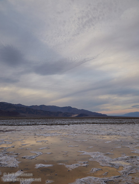 Light reflecting in puddles/pools in the salt flat, with the rough textured salt flats beyond (a bit like the Devils Golf Course), and the mountains under cloudy skies. (3/19/2013, West Side Road, Death Valley NP)<br /> EF24-105mm f/4L IS USM @ 28mm f/8 1/100s ISO800