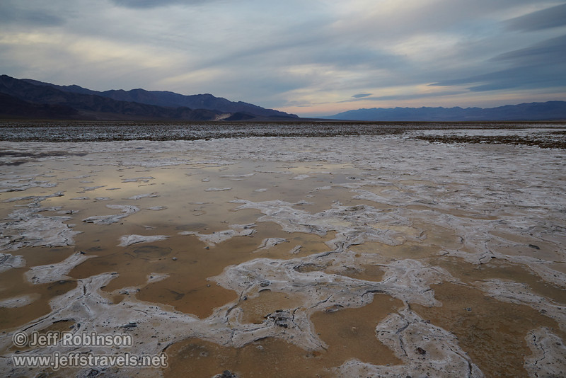 Light reflecting in puddles/pools in the salt flat, with the rough textured salt flats beyond (a bit like the Devils Golf Course), and the mountains under cloudy skies. (3/19/2013, West Side Road, Death Valley NP)<br /> EF24-105mm f/4L IS USM @ 24mm f/11 1/100s ISO1000