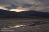 Light reflecting in puddles/pools in the salt flat, with the rough textured salt flats beyond (a bit like the Devils Golf Course), and the mountains under cloudy skies. (3/19/2013, West Side Road, Death Valley NP)<br /> EF24-105mm f/4L IS USM @ 45mm f/7 1/400s ISO400