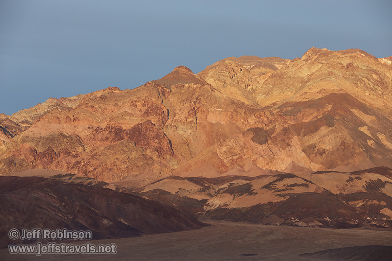 The very rough salt structures (a bit like the Devils Golf Course) in shade with colorful mountains in late sun in the background (Artist's Palette area). (3/19/2013, West Side Road, Death Valley NP)<br /> EF70-200mm f/2.8L IS II USM @ 165mm f/8 1/200s ISO320