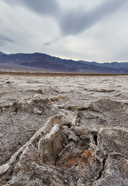 Westerly view of the Panamint Range over the rough lake bed (a bit like the Devil's Golf Course), with interesting cloud patterns in the sky. (3/19/2013, West Side Road, Death Valley NP)<br /> TS-E24mm f/3.5L II @ 24mm f/8 1/200s ISO320