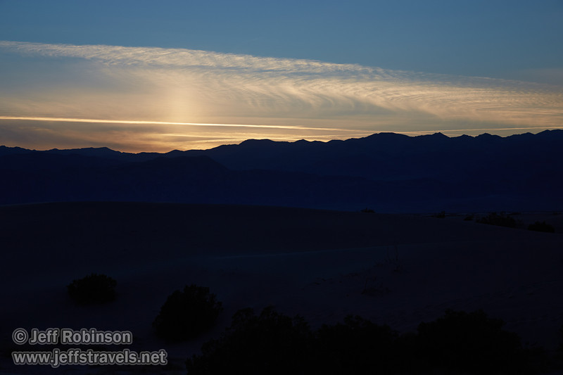 Westerly view of yellowish sunset clouds over the Panamint Range, with the silhouette of the Mesquite Flat Sand Dunes in the foreground. (3/19/2013, Mesquite Flat Sand Dunes, Death Valley NP)<br /> EF24-105mm f/4L IS USM @ 73mm f/9 1/200s ISO400