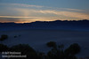 Westerly view of yellowish sunset clouds over the Panamint Range, with the silhouette of the Mesquite Flat Sand Dunes in the foreground. (3/19/2013, Mesquite Flat Sand Dunes, Death Valley NP)<br /> EF24-105mm f/4L IS USM @ 75mm f/8 1/100s ISO400