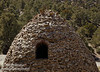 View of the back side of one of the kilns, including its window. Each beehive-shaped kiln is about 25 feet high. (3/19/2013, Charcoal Kilns, Wildrose Canyon, Death Valley NP)<br /> EF24-105mm f/4L IS USM @ 84mm f/11 1/200s ISO200