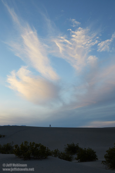 Northerly view of a photographer on a dune ridge, with the last bits of sun on the wispy clouds in blue sky above him. (3/19/2013, Mesquite Flat Sand Dunes, Death Valley NP)<br /> EF24-105mm f/4L IS USM @ 40mm f/8 1/125s ISO400