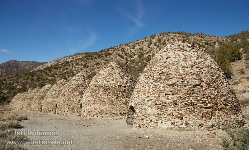Front view of 9 of the charcoal kilns under mostly blue skies. Each beehive-shaped kiln is about 25 feet high. (3/19/2013, Charcoal Kilns, Wildrose Canyon, Death Valley NP)<br /> EF24-105mm f/4L IS USM @ 24mm f/10 1/200s ISO100