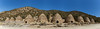 Panoramic sweep of the 10 charcoal kilns from the front (road) side. Each beehive-shaped kiln is about 25 feet high. (3/19/2013, Charcoal Kilns, Wildrose Canyon, Death Valley NP)<br /> EF24-105mm f/4L IS USM @ 24mm f/8 1/400s ISO100