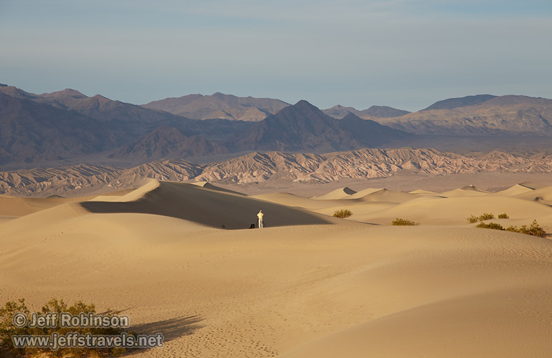 A photographer on the Mesquite Flat dunes, with the reddish foothills and mountains of the Amargosa Range are in the background. (3/19/2013, Mesquite Flat Sand Dunes, Death Valley NP)<br /> EF24-105mm f/4L IS USM @ 105mm f/8 1/640s ISO400