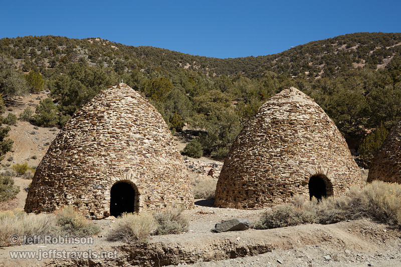 Two of the charcoal kilns. Light coming through one of the vents on the back wall can be seen through the door of the left kiln. Each beehive-shaped kiln is about 25 feet high. (3/19/2013, Charcoal Kilns, Wildrose Canyon, Death Valley NP)<br /> EF24-105mm f/4L IS USM @ 47mm f/8 1/200s ISO100