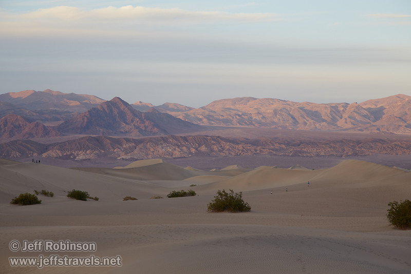 Scattered people on the dunes. The last bit of sunlight has pretty much left the dunes, but is still catching the reddish foothills of the Grapevine Mountains of the Amargosa Range in the background. (3/19/2013, Mesquite Flat Sand Dunes, Death Valley NP)<br /> EF24-105mm f/4L IS USM @ 105mm f/7 1/200s ISO400