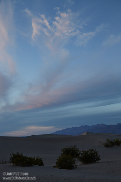 NE view of creosote bushes and the Mesquite Flat Sand Dunes in shade, with the last bits of sun on wispy clouds in the blue sky above. (3/19/2013, Mesquite Flat Sand Dunes, Death Valley NP)<br /> EF24-105mm f/4L IS USM @ 40mm f/6.3 1/125s ISO400