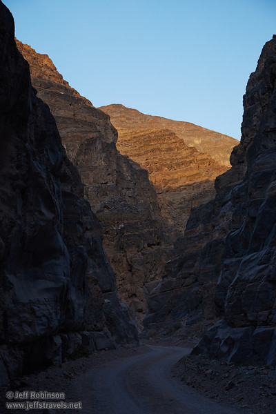 Titus Canyon Road twists through the canyon. The near cliffs are in shade, while some of the farther cliffs have late sun on them under blue sky. (3/20/2013, Titus Canyon, Death Valley NP)<br /> EF24-105mm f/4L IS USM @ 65mm f/5.6 1/125s ISO200
