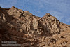 Looking up at the textured reddish-brown and grey canyon wall under partly cloudy blue sky. (3/20/2013, Titus Canyon, Death Valley NP)<br /> EF24-105mm f/4L IS USM @ 70mm f/7 1/320s ISO200