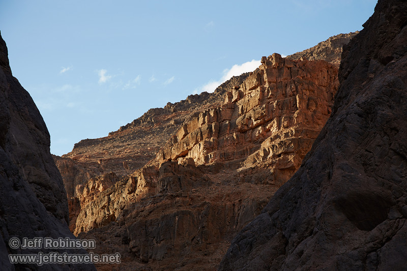 Late sun adds texture to the rocky grey and reddish-brown cliff wall under partly-cloudy blue sky. (3/20/2013, Titus Canyon, Death Valley NP)<br /> EF24-105mm f/4L IS USM @ 80mm f/5.6 1/160s ISO200