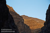 The near cliffs of Titus Canyon are in shade, while some of the farther cliffs have late sun on them under blue sky. (3/20/2013, Titus Canyon, Death Valley NP)<br /> EF24-105mm f/4L IS USM @ 95mm f/5.6 1/125s ISO200