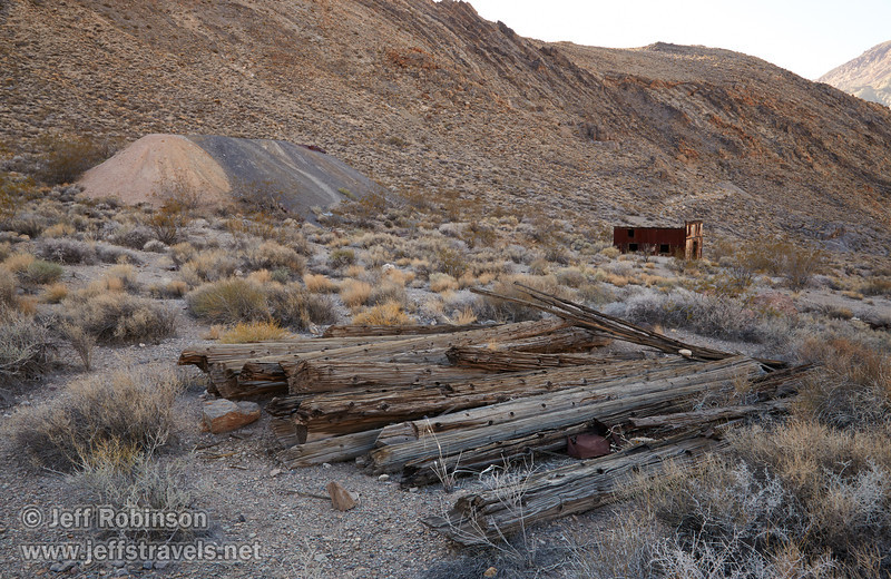 The logs of an old structure in the foreground, with mine tailings and an old corrugated metal building in the background at the ghost town of Leadfield. (3/21/2013, Leadfield (ghost town), Titus Canyon Road, Death Valley NP)<br /> EF24-105mm f/4L IS USM @ 28mm f/13 1/50s ISO400