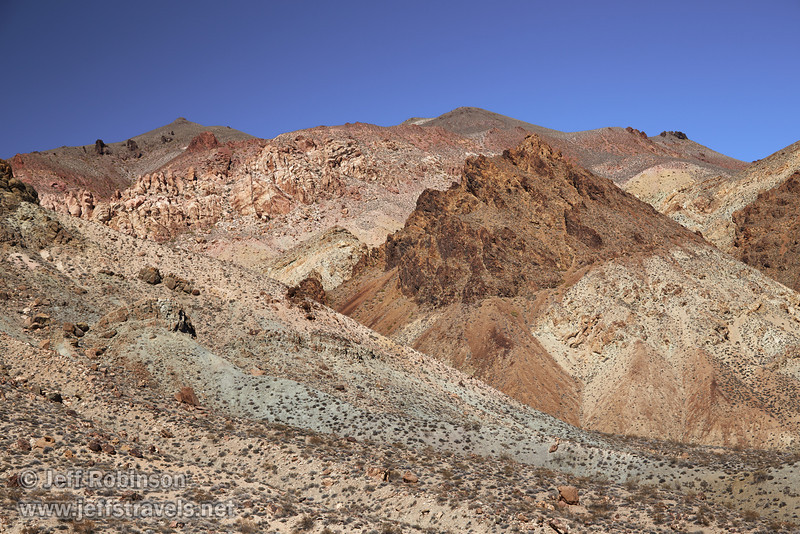 Desert mountain colors include shades of reds, browns, yellows, and greens, all under deep blue sky. (3/21/2013, Titus Canyon Road, Death Valley NP)<br /> EF24-105mm f/4L IS USM @ 55mm f/7 1/200s ISO200