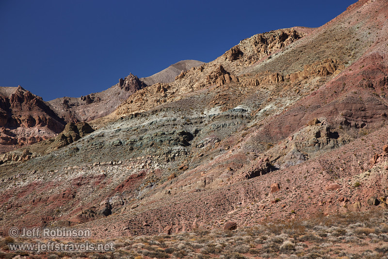 A colorful hillside with reds, greens, and yellows under blue sky. (3/21/2013, Titus Canyon Road, Death Valley NP)<br /> EF24-105mm f/4L IS USM @ 88mm f/7 1/200s ISO200