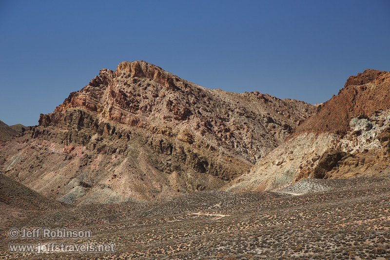 Slanted layers of rock in a mountain include pale green, yellows, and reds under deep blue sky. (3/21/2013, Titus Canyon Road, Death Valley NP)<br /> EF24-105mm f/4L IS USM @ 100mm f/7 1/200s ISO200