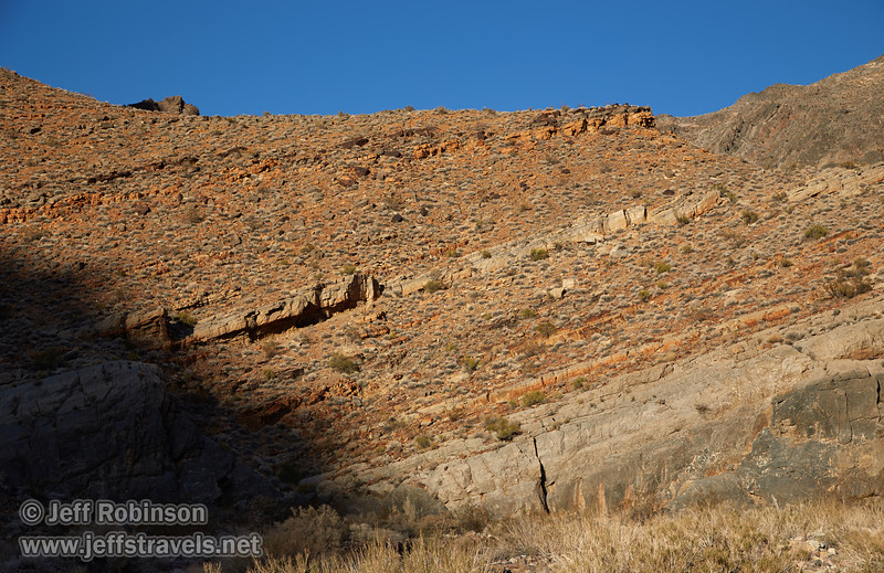 Angled layers of rock in the hillside (including some orange) under blue sky. (3/21/2013, Titus Canyon, Titus Canyon Road, Death Valley NP)<br /> EF24-105mm f/4L IS USM @ 67mm f/7 1/200s ISO100