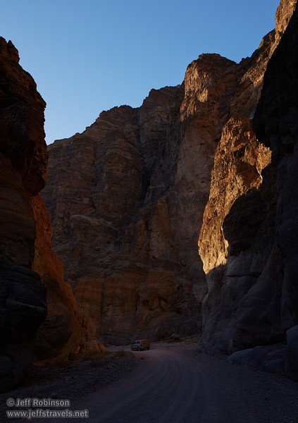 Late sun on a small part of the cliff wall casts golden reflected light onto the opposite wall, with my truck on Titus Canyon Road at the bottom. (3/21/2013, Titus Canyon, Titus Canyon Road, Death Valley NP)<br /> TS-E24mm f/3.5L II @ 24mm f/8 1/100s ISO250