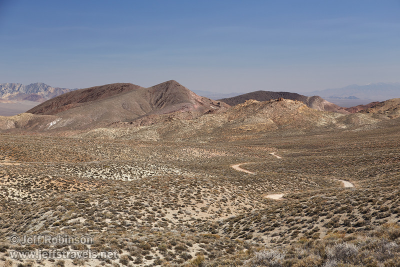 Easterly view of Titus Canyon Rd. snaking through the arid valley with desert mountains beyond. (3/21/2013, Titus Canyon Road, Death Valley NP)<br /> EF24-105mm f/4L IS USM @ 70mm f/7 1/200s ISO200