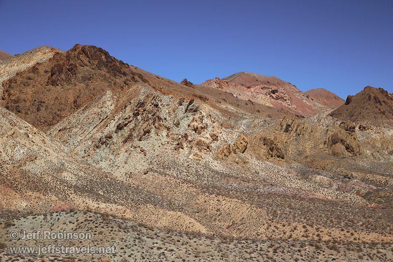 Desert mountain colors include shades of reds, browns, yellows, and greens, all under deep blue sky. (3/21/2013, Titus Canyon Road, Death Valley NP)<br /> EF24-105mm f/4L IS USM @ 58mm f/7 1/200s ISO200