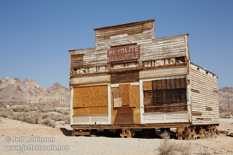 The Rhyolite Mercantile, boarded up and on wooden blocks (located near Tom Kelly's Bottle House). (3/22/2013, Rhyolite (ghost town), Death Valley trip)<br /> EF24-105mm f/4L IS USM @ 55mm f/10 1/320s ISO160