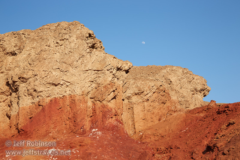 The moon in blue sky over the red and grey cliff (seen from the parking lot for Golden Canyon). (3/22/2013, Golden Canyon, Death Valley NP)<br /> EF24-105mm f/4L IS USM @ 50mm f/9 1/160s ISO125