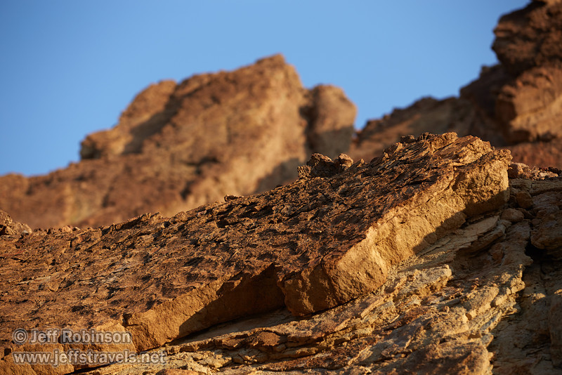 Close-up of a layer of the textured rock surface in the yellow-brown cliff side under blue sky. (3/22/2013, Golden Canyon, Death Valley NP)<br /> EF70-200mm f/2.8L IS II USM @ 142mm f/4 1/400s ISO100