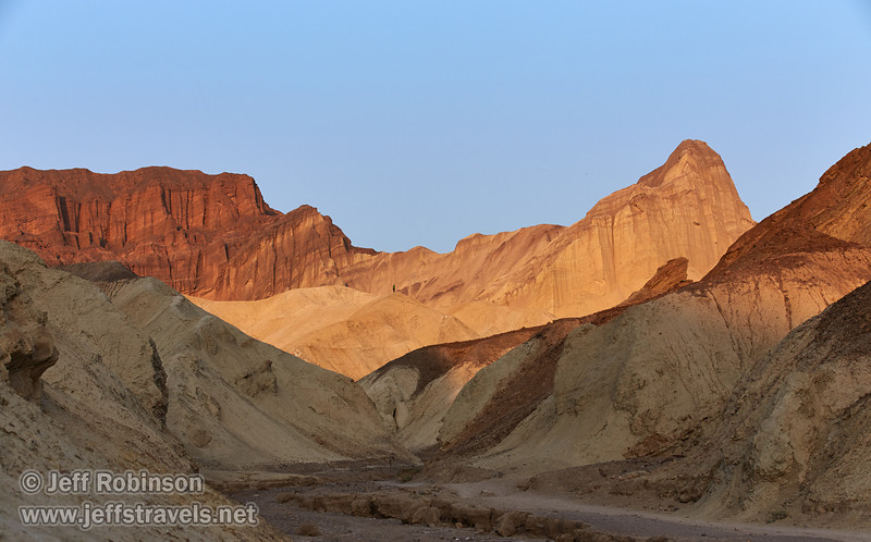 A distant hiker on a hill adds perspective to the late sun on the canyon walls with their hues of reds, yellows, and browns. (3/22/2013, Golden Canyon, Death Valley NP)<br /> EF70-200mm f/2.8L IS II USM @ 75mm f/8 1/400s ISO400