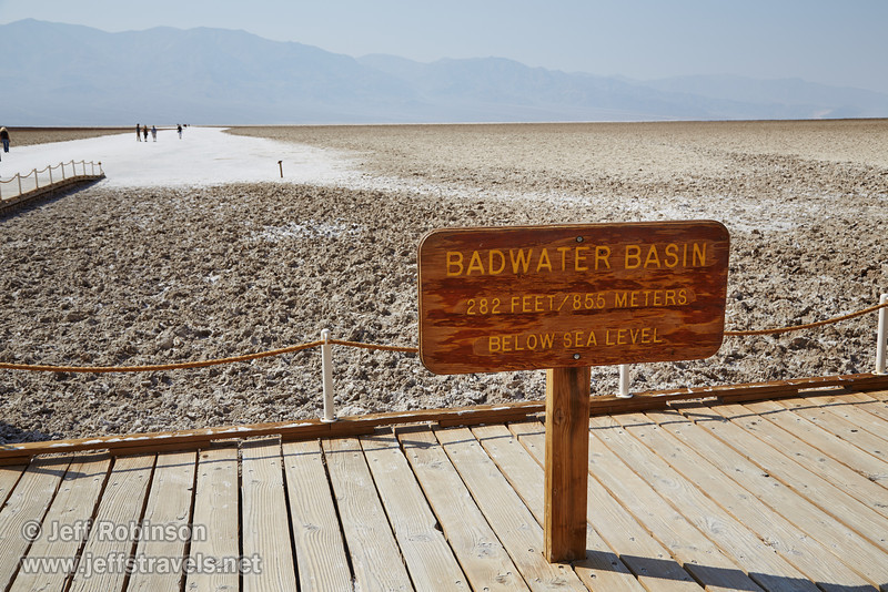 """Badwater Basin - 282 Feet / 85.5 Meters Below Sea Level"" sign on the boardwalk at Badwater Basin, with the salt flat behind it. The rough, brown area is what most of the lake bed looks like. The bright white is the smooth area walked on by tourists. (I overheard a ranger saying that the sign is actually at more like 280 feet. You have to walk out a couple of miles if you want to get down to 282 feet below sea level.) (3/22/2013, Badwater Basin, Death Valley NP)<br /> EF24-105mm f/4L IS USM @ 35mm f/9 1/250s ISO100"